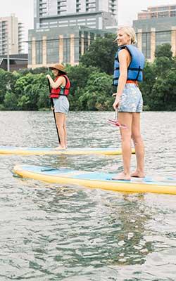 Women Paddleboarding