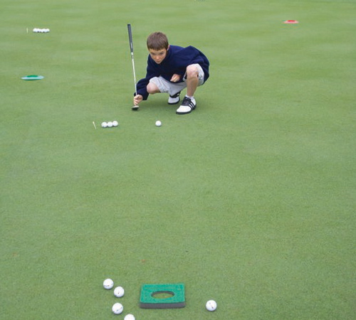 Carmel-Valley-Ranch_Golf_little-boy-putting-gaze-CRPD500x450