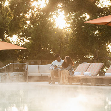 Carmel-Valley-Ranch_Lifestyle_lodge-pool_couple-drinking-wine_small