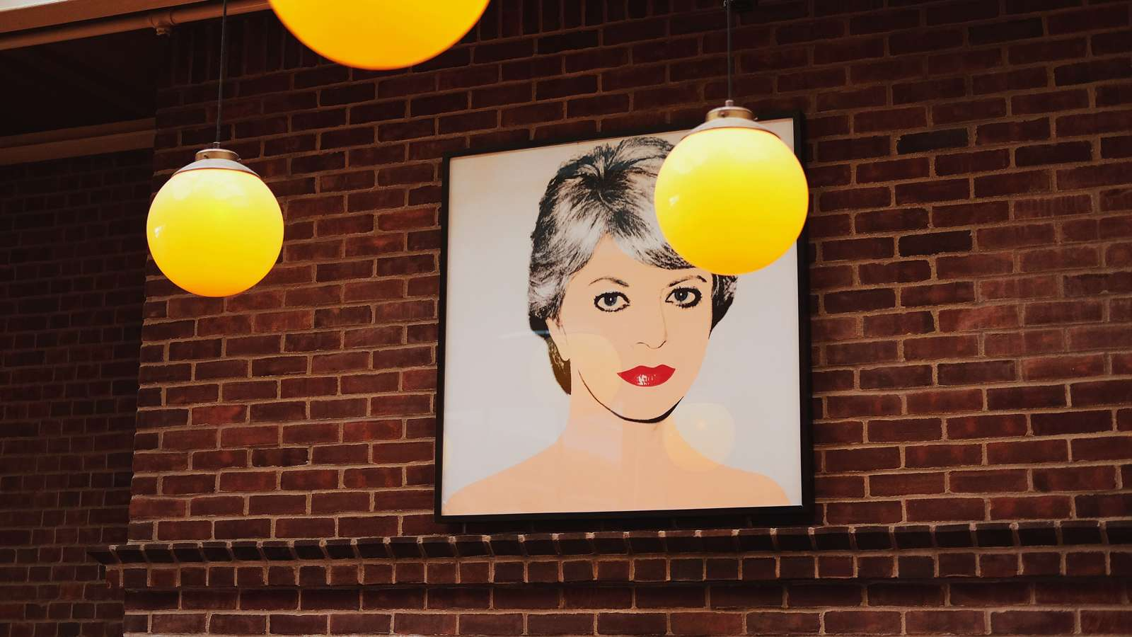 Hung over the fireplace in the Private Dining Room at Cindy's, this original Andy Warhol portrait was done of Cindy Pritzker in 1982.