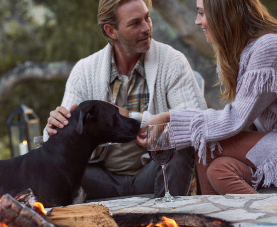 Carmel Valley Ranch_Lifestyle_Campfire_Couple_Cocktails_dog Laine_4489_GJ