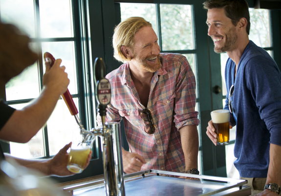 Carmel Valley Ranch_Lifestyle_Play_guys drinking beer at bar at River Ranch