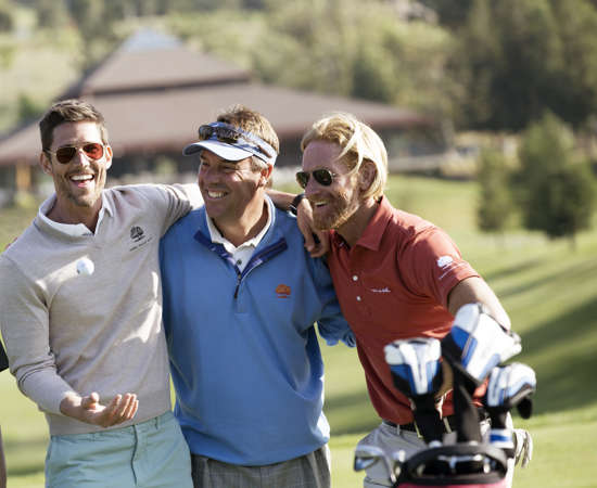 Guys enjoying comradery on the golf course
