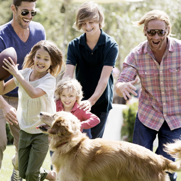 Carmel Valley Ranch_Lifestyle_Play_family and dog playing at River Ranch