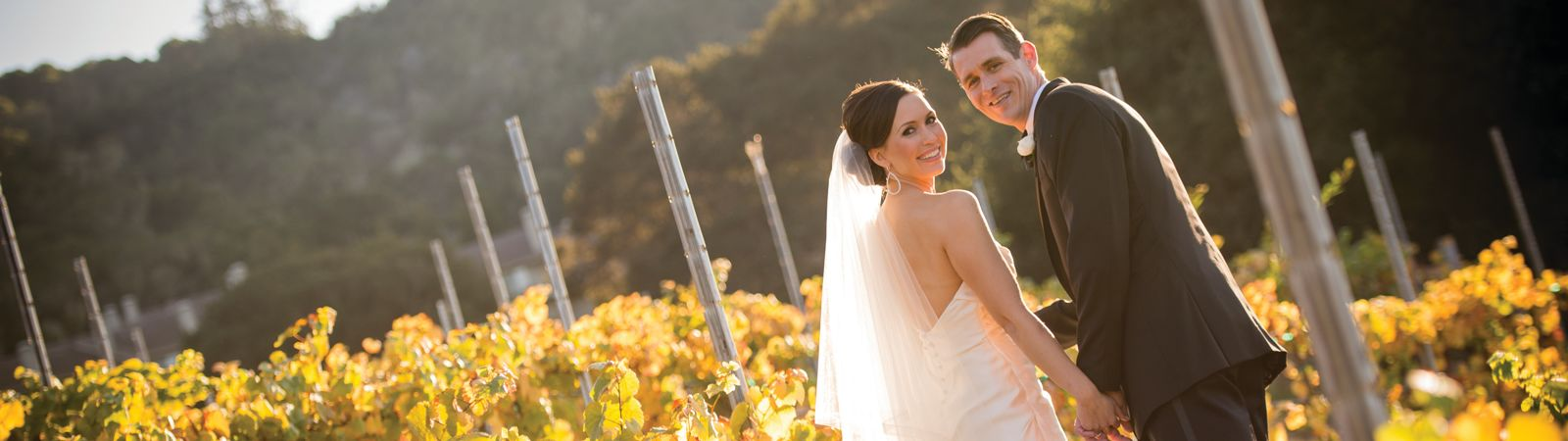 Carmel Valley Ranch_Wedings_wedding couple in fall vineyard