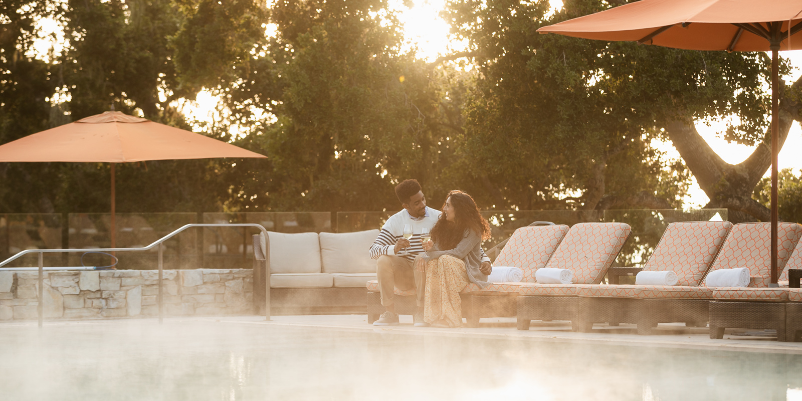Carmel Valley Ranch_Lifestyle_lodge pool_couple drinking wine_3786_KD
