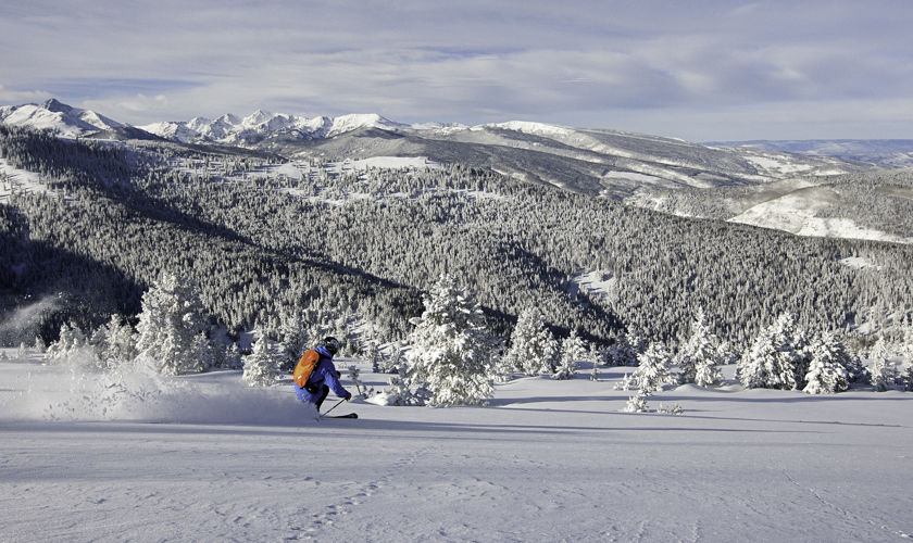 <b>Skier turns in fresh powder in Vail, CO.</b>