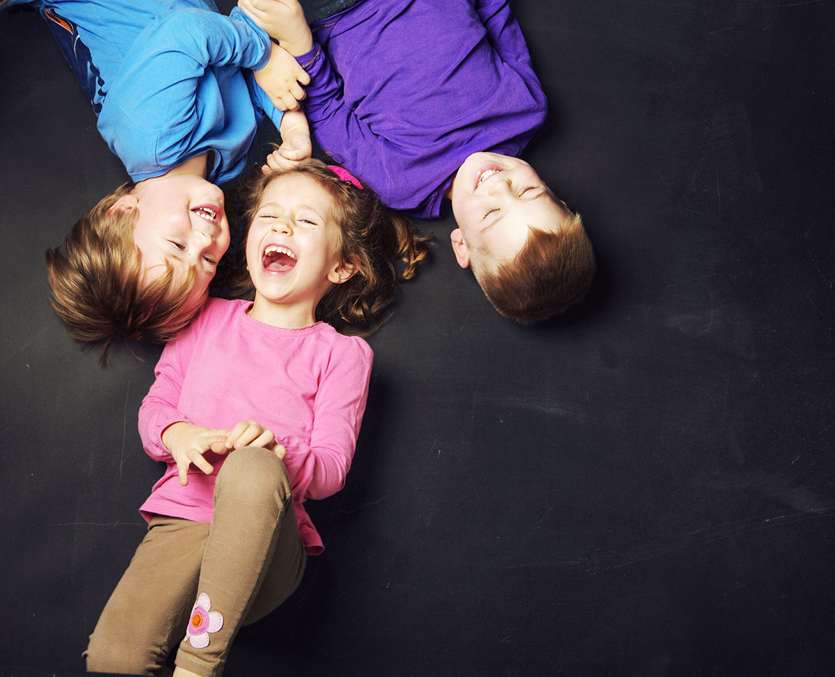 Kids laying down laughing