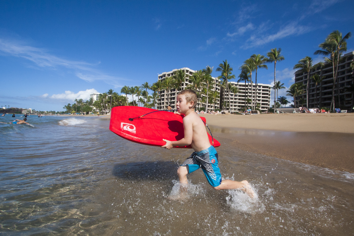 Boy With Red Boogie Board