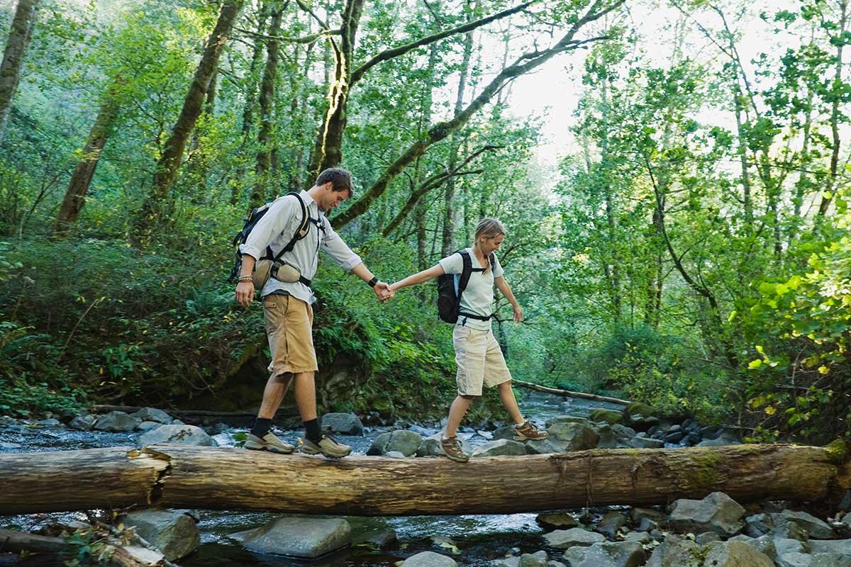 People Crossing Stream