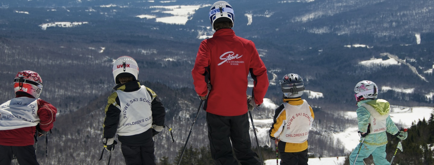 kids and instruction skier