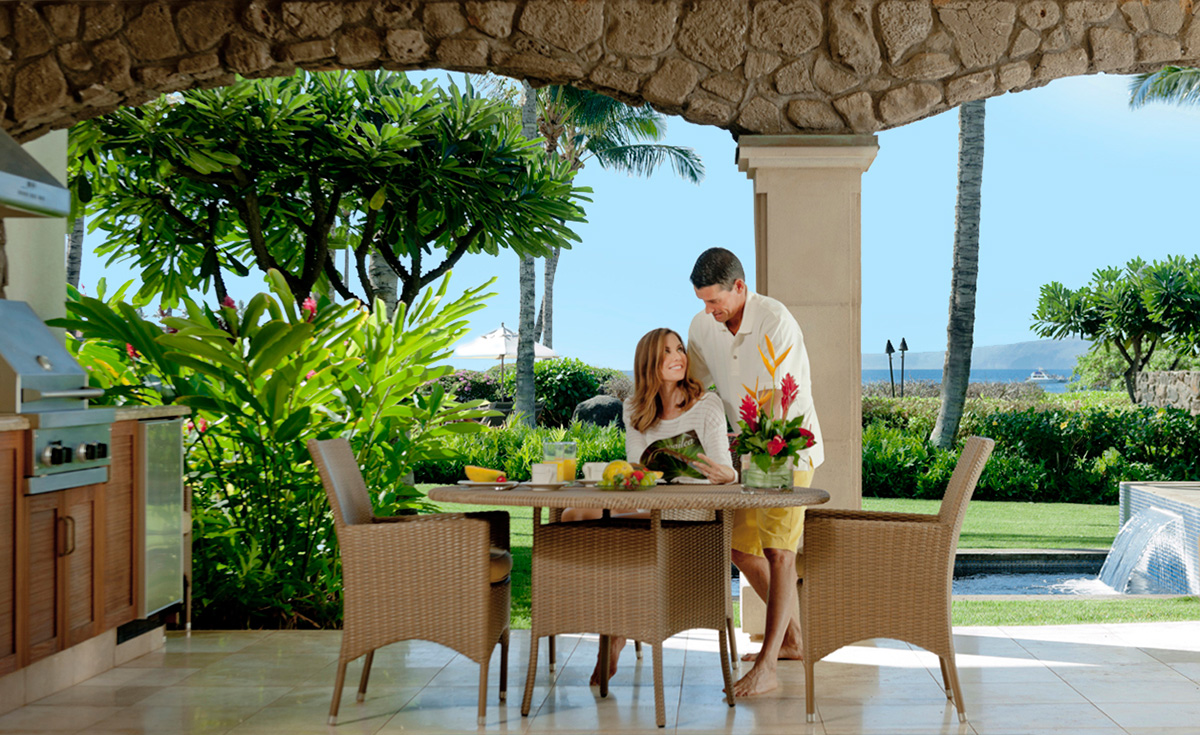 Couple on lanai by infinity pool at Wailea Beach Villas