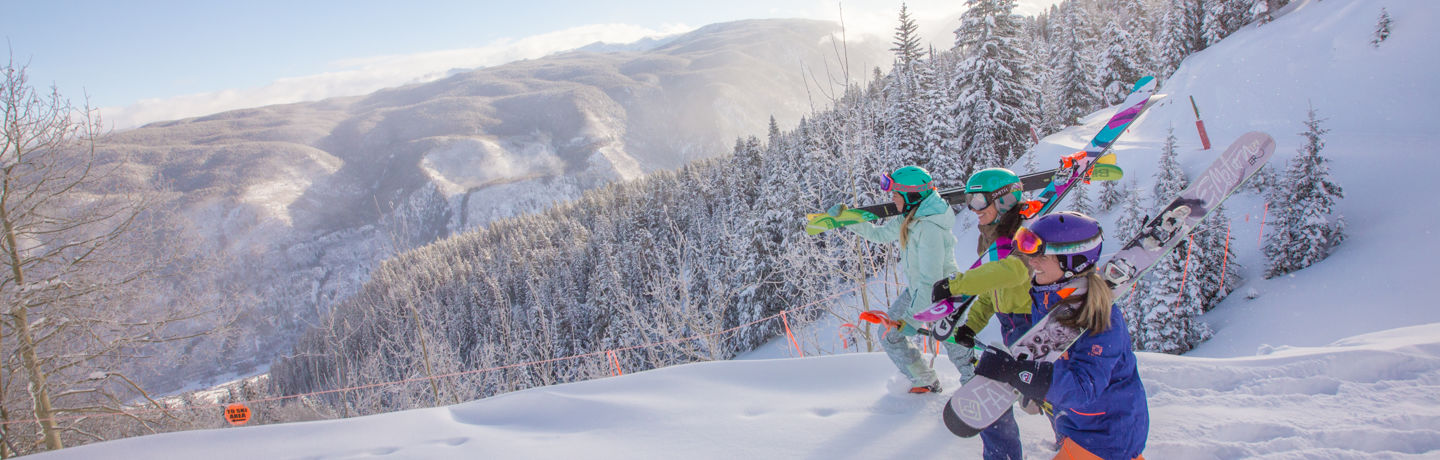 Female skiers hiking for powder lines in Aspen Snowmass