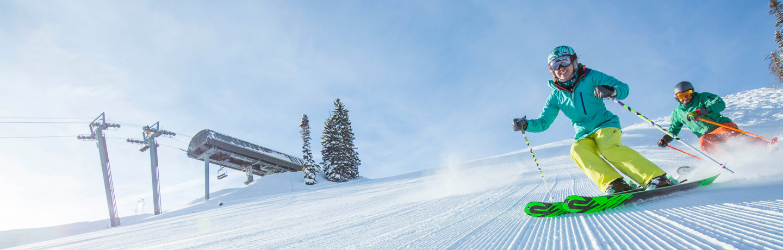 Groomer Skiers Downhill