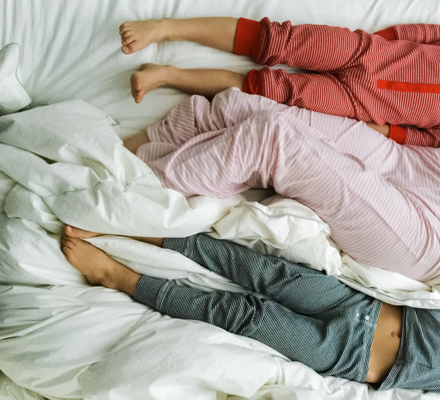 Kids Laying In Bed