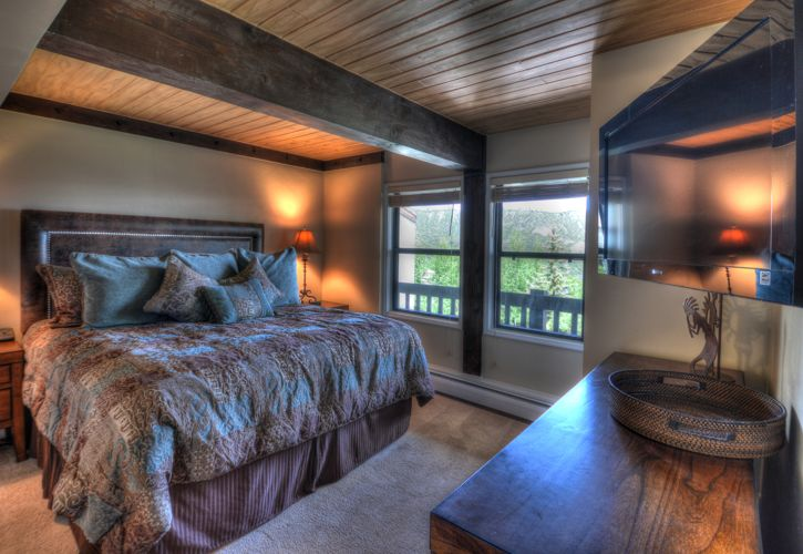 Master bedroom at the Interlude condominiums, Snowmass Village, CO