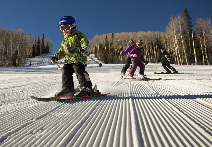 Child and family skiing Snowmass