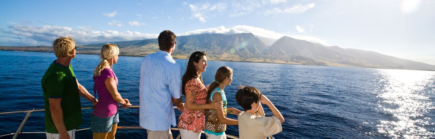 Group on boat viewing the West Maui Mountains