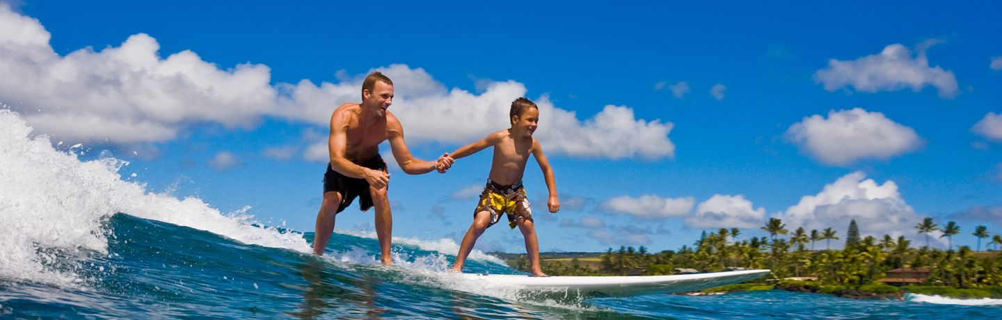Father and son tandem surfing