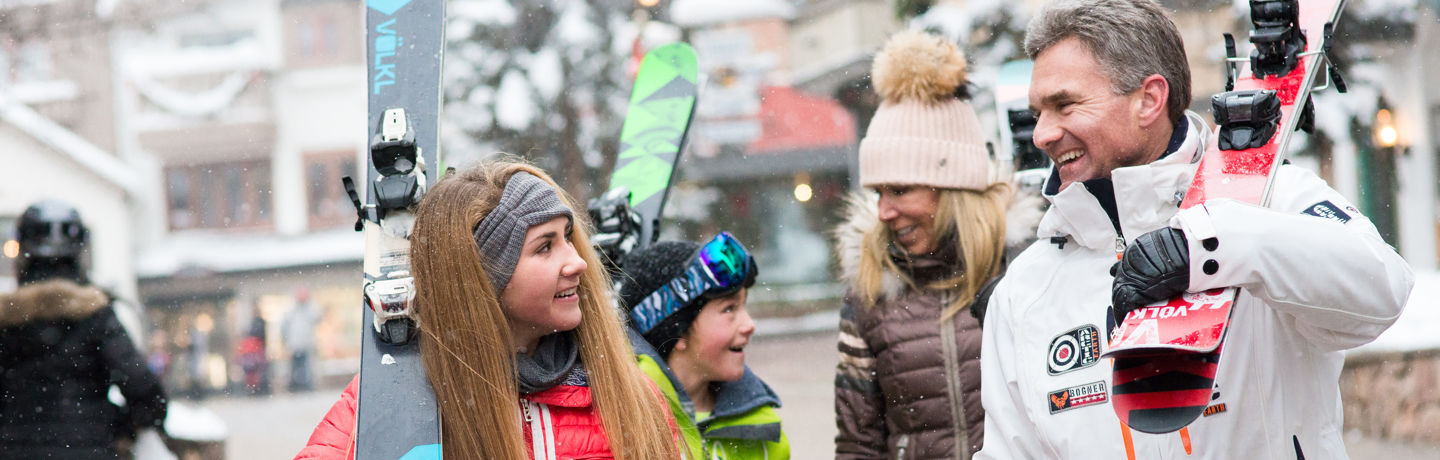 Family Strolls through Village after Skiing in Vail, CO.
