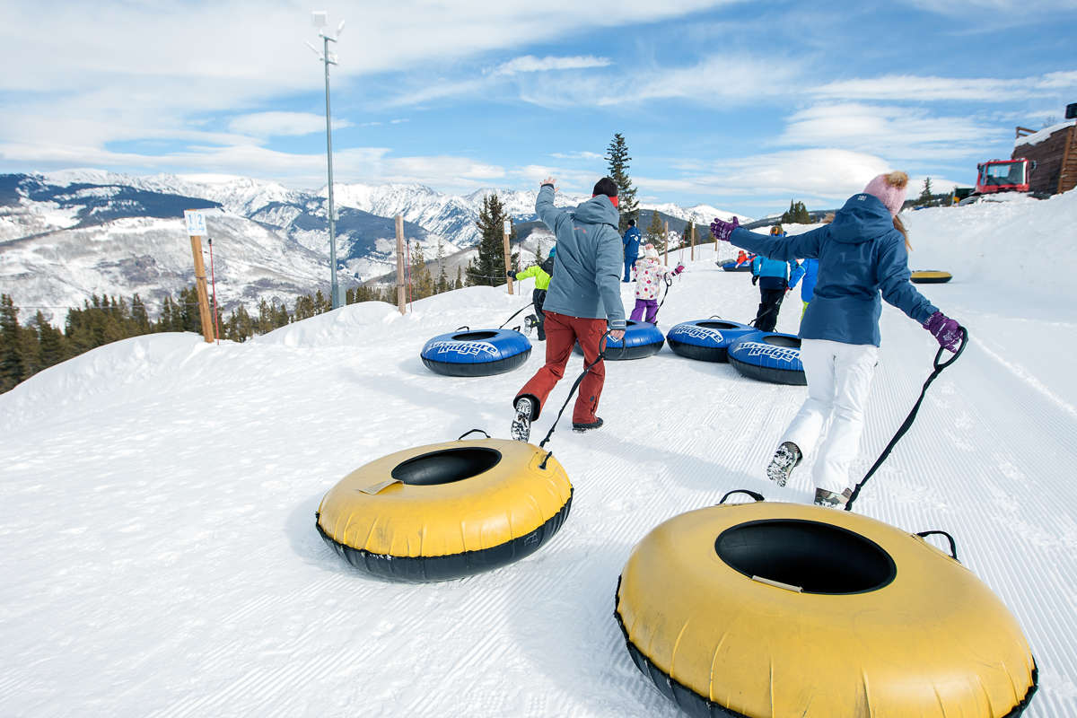 People Riding Snow Cats
