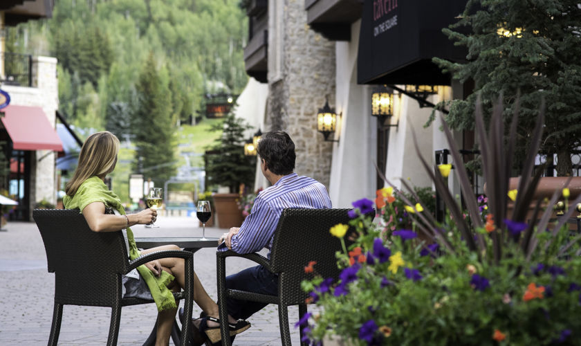 Couple enjoys apres in vaillage in Vail, CO