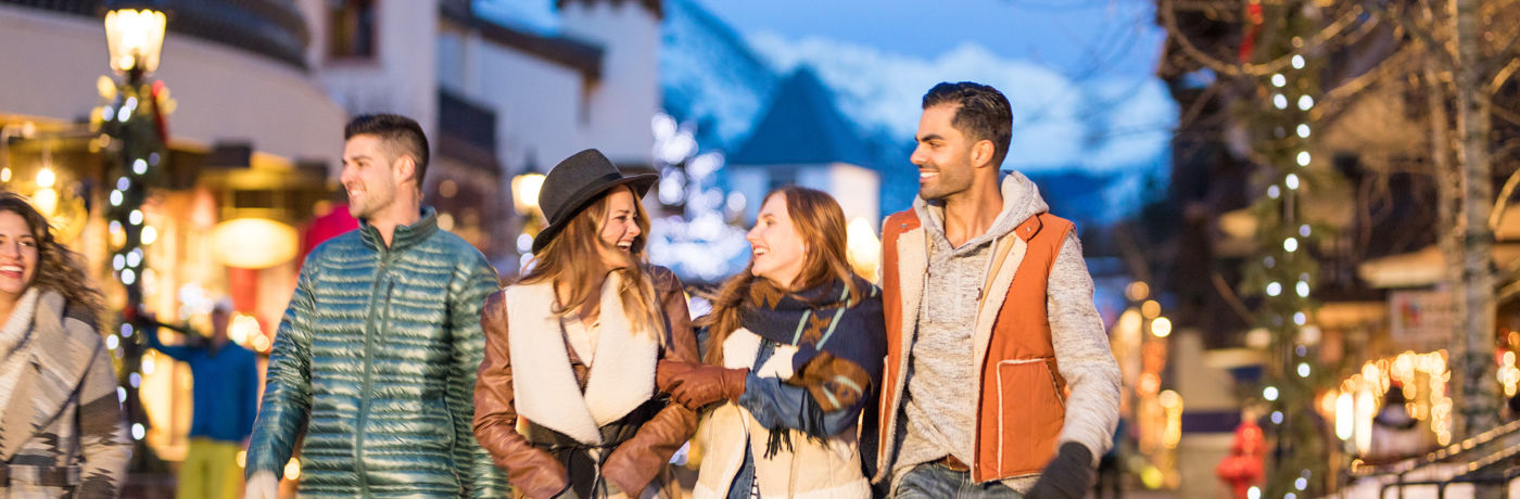 Young and Independents walk in the outdoor nightlife in Vail, CO.