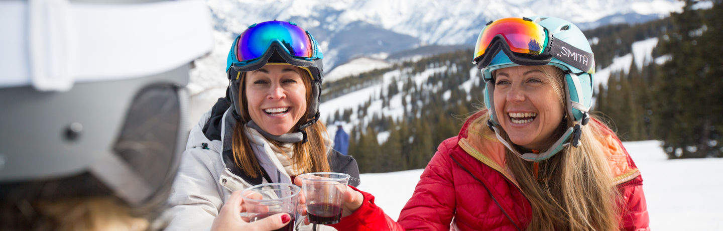 Ladies Take Lunch Break on Mountain in Vail, CO.
