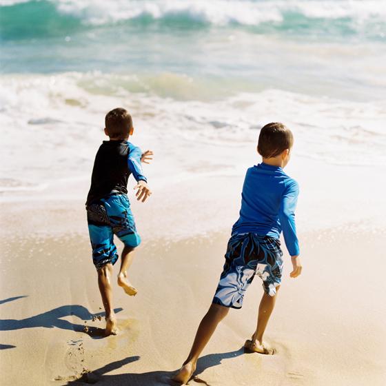 Boys play on beach