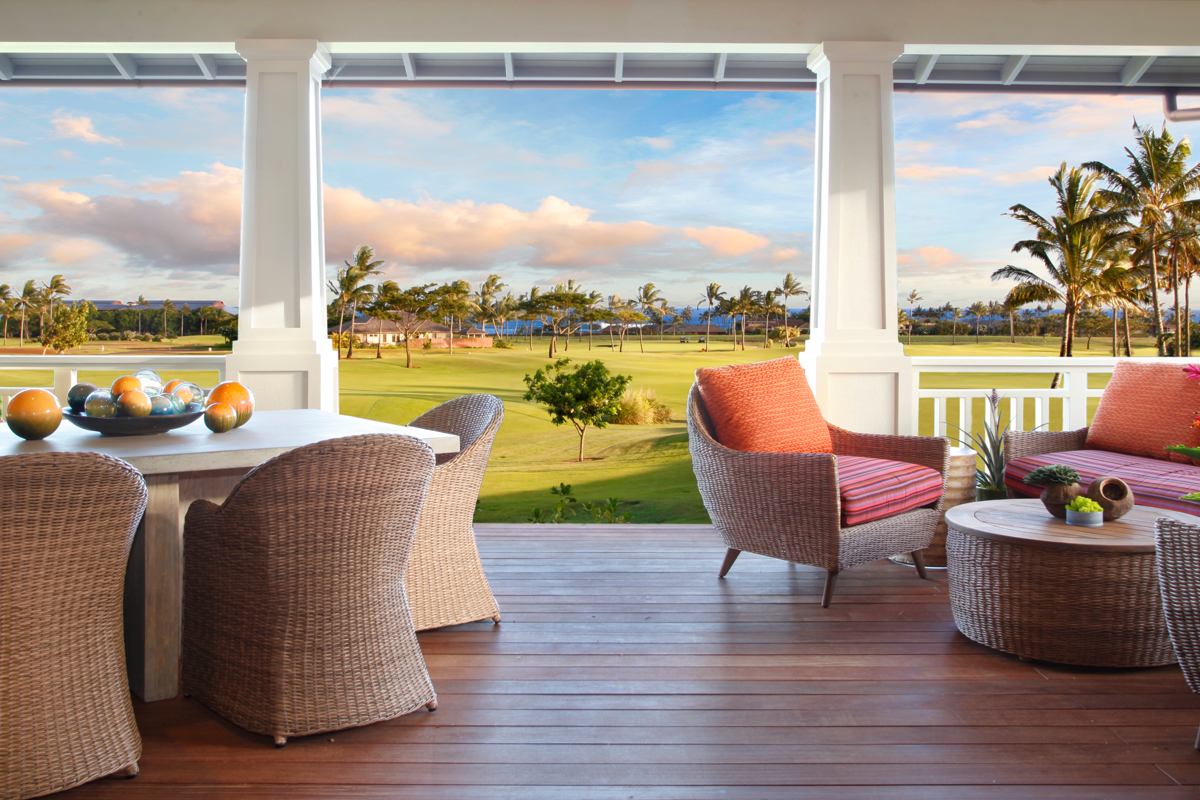 Spacious main floor lanai with dining table for six and comfortable seating area. View over fairway to ocean.