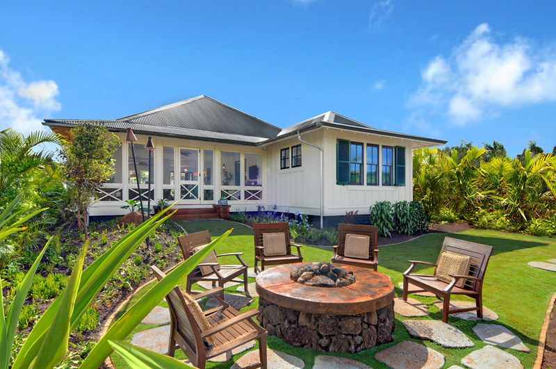 Private backyard fire pit patio off lanai with comfortable seating for five to enjoy the evening breeze and stars.