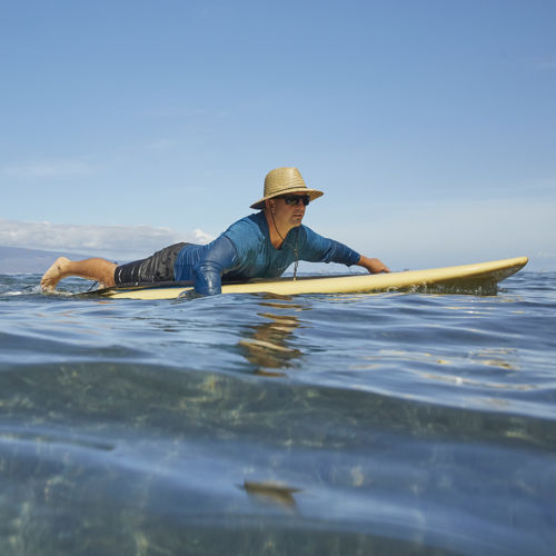 paddling in a wave