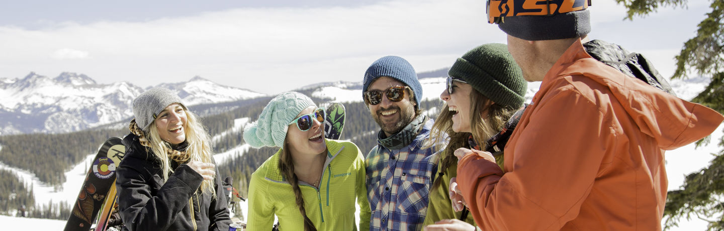 <b>Group of friends eats and drink on mountain top deck in Vail, CO.</b>