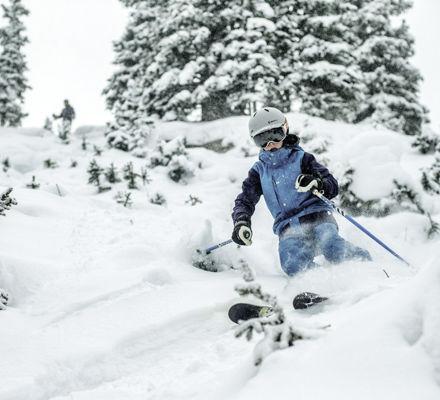 <b>Kid skis in powder in Vail, CO.</b>