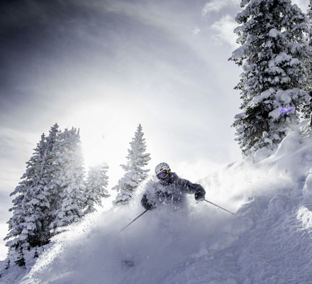 <b>Skier in back bowls powder in Vail, CO.</b>