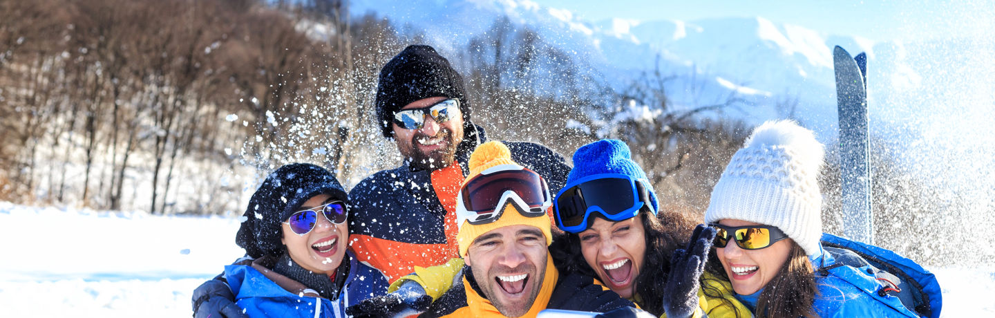 Group Smiling For Selfie In Winter