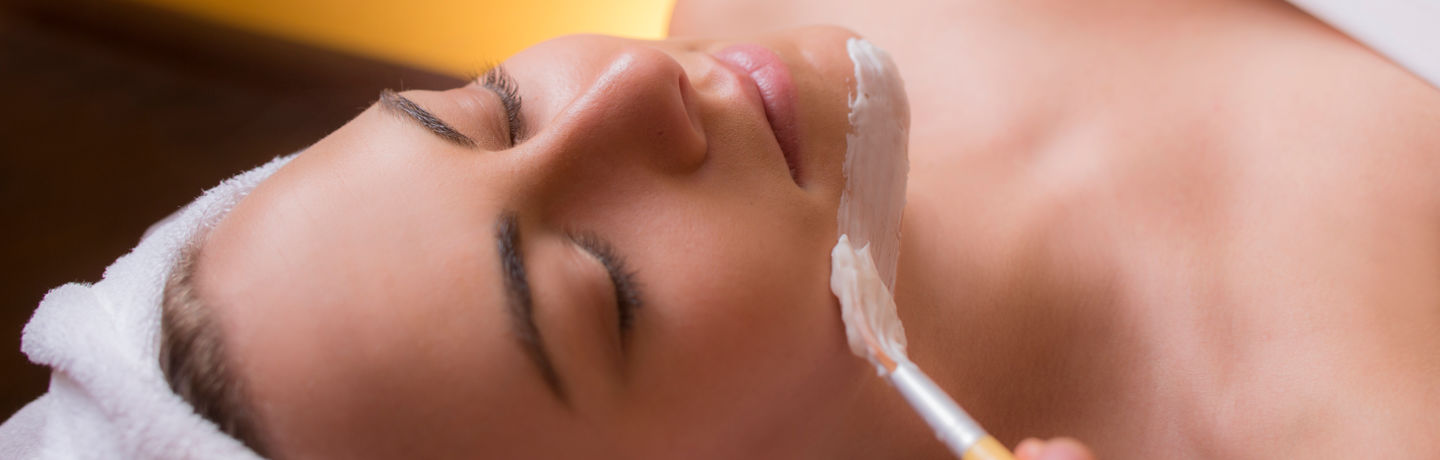 Woman Getting Spa Facial Mask