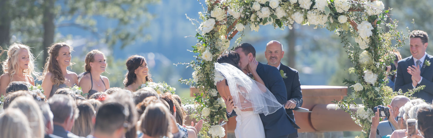 Bride And Groom Kissing At Wedding Ceremony