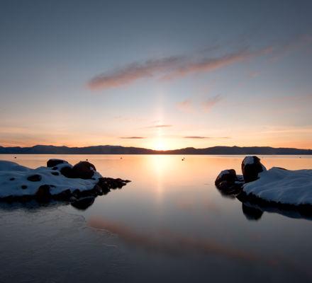Sunrise Over Lake & Snowy Rocks