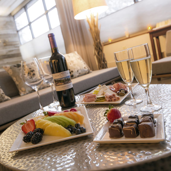 The Tranquility Rooms spa packages include wine and champagne, in addition to hors d'oeuvres like cheese platters, truffles, and crudité.