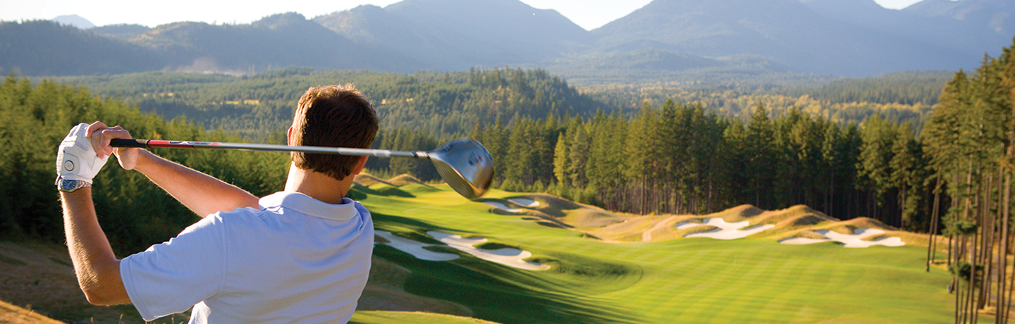 Golfer Teeing Off at Suncadia Resort Near Seattle