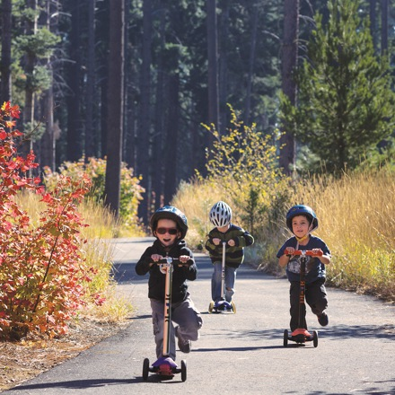 group of kids riding their scooters