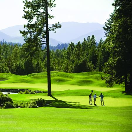 Suncadia Resort With Mountain Range In Background