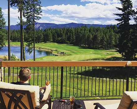 man sitting on a deck looking at the golf course