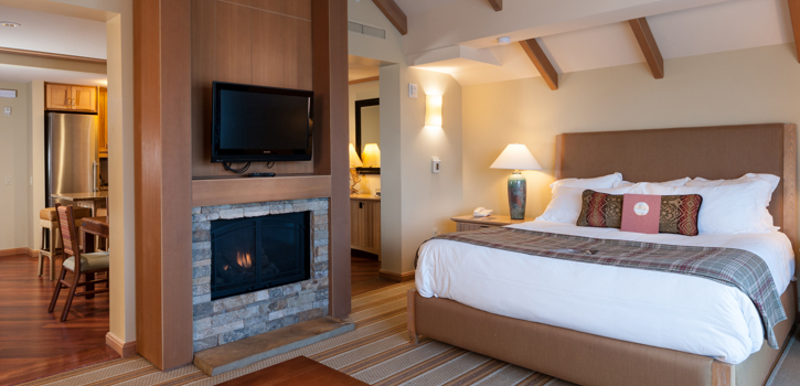 king bed lodge with fireplace in the room