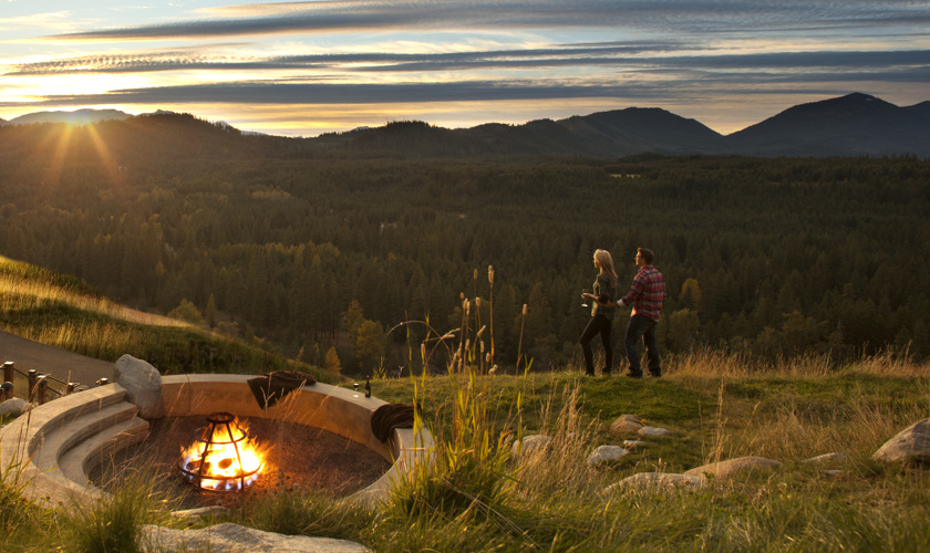 a couple by the fire on suncadia property