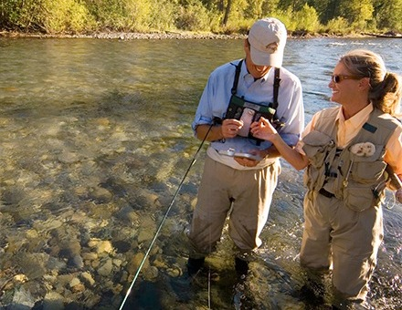 couple fly fishing together
