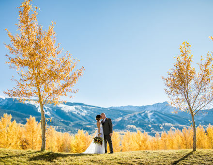 Sharing a first kiss in front of Snowmass' stunning mountains
