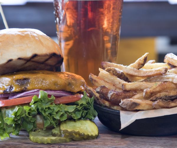 Monday night's special - the signature burger, fries, and a beer from The Artisan, inside the Stonebridge Inn, Snowmass Village, Colorado