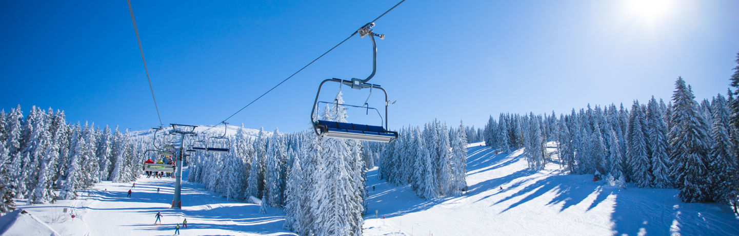 Ski Lift Above Snowy Slopes